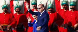Turkish President Erdogan, accompanied by his wife Emine, greets supporters during a rally to mark the 563rd anniversary of the conquest of the city by Ottoman Turks, in Istanbul