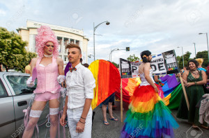 Participants of the Gay Pride parade march through the city of